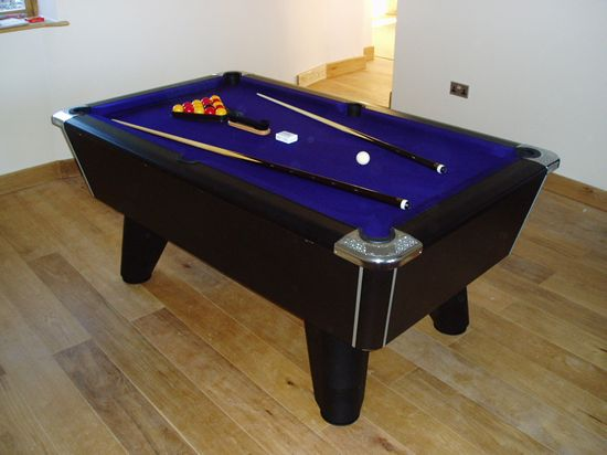 Black winner pool table with  purple cloth