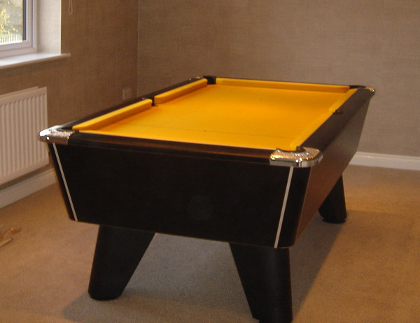 Black winner pool table with gold  cloth