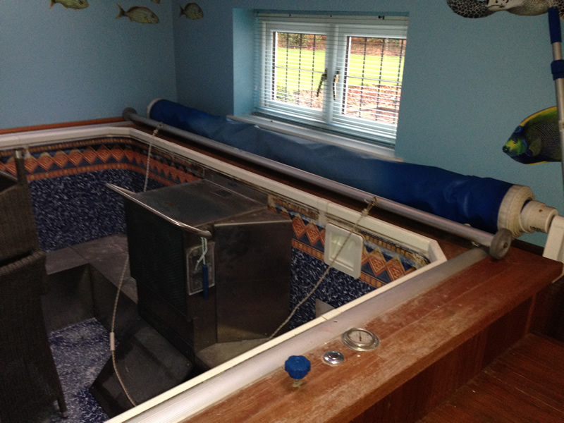 Existing pool room before transformation