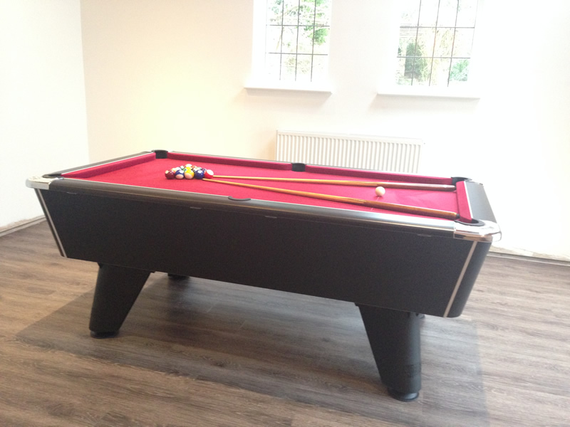 Black winner pool table with burgundy cloth