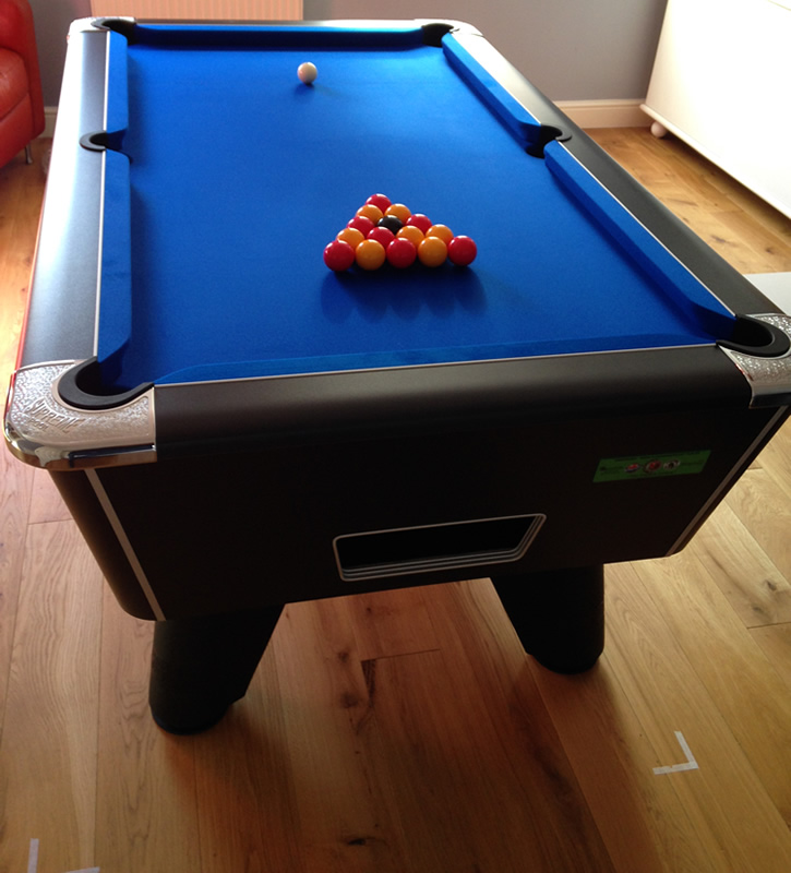 Black winner pool table  with blue cloth
