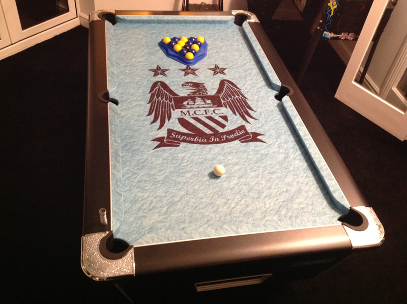 Black winner pool table with Manchester City cloth